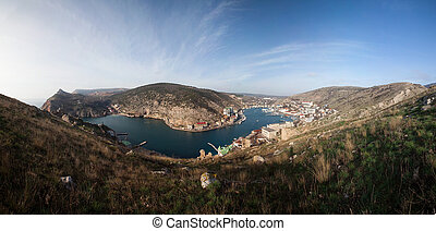 Beautiful view of the Black Sea and the city Balaklava. Balaklava Bay. Clear sunny day and a top view of the port, Crimea