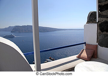 Beautiful view of the caldera from a balcony in Oia, Santorini, Greece.