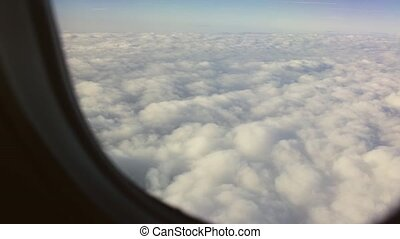 Beautiful View of The Clouds from a Plane Window
