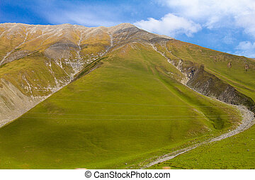 Beautiful view of the landscape of the Georgian military road on a Sunny summer day. The road connects the city of Vladikavkaz, Russia and Tbilisi, Georgia.