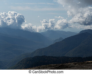 Beautiful view of the mountain range with blue sky and clouds