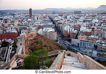 Beautiful view of the old town and Mount Benacantil from Santa Barbara Castle. Enjoying the sunset. Alicante, Spain.