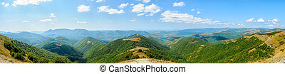 Beautiful view of the peaks of the Caucasus mountains on a Sunny day. Panorama