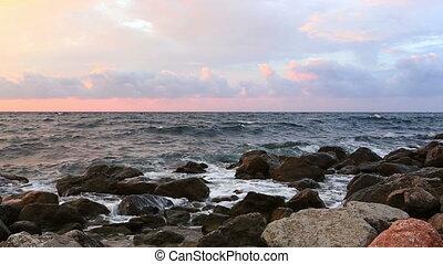 Beautiful view of the sea coast at sunrise, panning