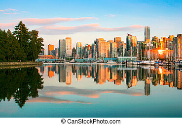 Beautiful view of Vancouver skyline with Stanley Park at sunset