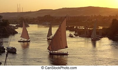 Beautiful view on felucca boats on Nile river in Aswan at sunset, Egypt, 4k