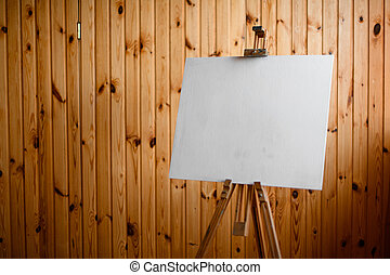beautiful view on wooden easel with clean white canvas.