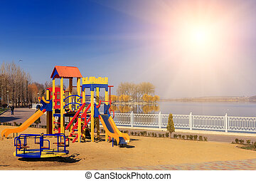 beautiful views. playground on the lake in a city park