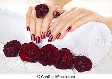 vinous manicure with rose flowers. spa - beautiful vinous...