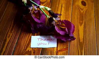 beautiful violet iris flower on a wooden table