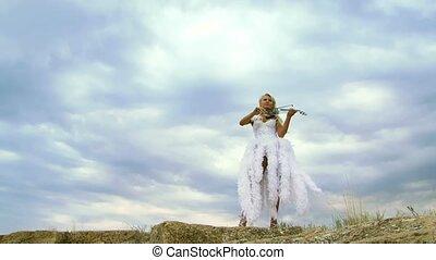 Beautiful Violinist In A White Dress