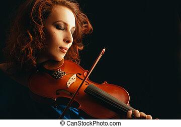 beautiful violinist playing violin