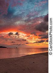 Beautiful vivid sunset at paradise beach