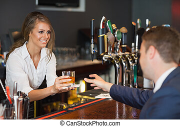 Beautiful waitress serving handsome businessman in a classy ...
