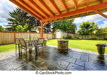 Beautiful walkout patio area - Pergola with patio area. Tile...