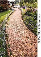 Beautiful walkway winding through a tranquil garden