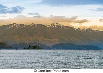 Beautiful Wanaka lake with snow mountain background