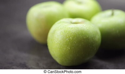 Beautiful washed green apples on the table