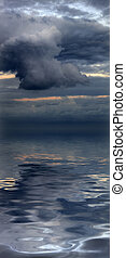 Beautiful water reflection of evocative cloudscape - ...