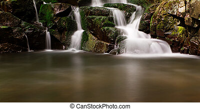 Beautiful and peaceful waterfall in the nature