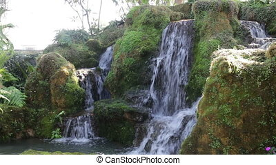 Beautiful waterfall created in home garden, stock footage
