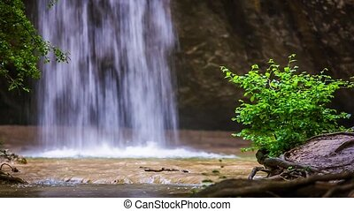 Beautiful Waterfall Falling Down In Forest