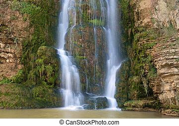 waterfall - beautiful waterfall falling on a rock wall