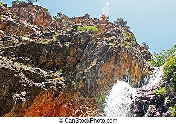 Beautiful waterfall in mountain valley