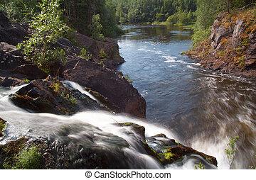 Beautiful waterfall in summer season