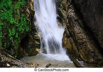 beautiful waterfall in the mountains