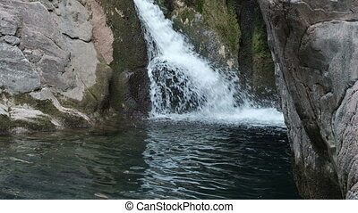 Beautiful waterfall in wild nature among rocks - Beautiful...