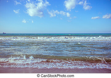 Beautiful wave on sea and blue sky with clouds