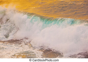 beautiful waves at the beach in sunset