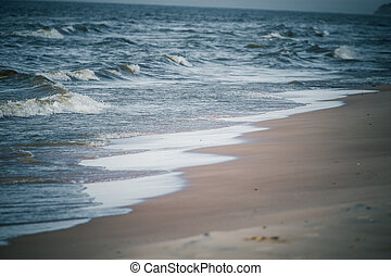 Beautiful waves breaking on the shore of Baltic sea.