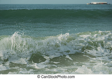 Beautiful waves of South China Sea on Dadonghai beach. - ...