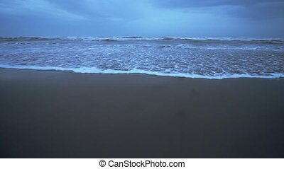 Beautiful waves on the isolated evening beach in winter