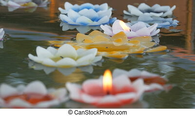 Beautiful wax colored candles in the form of lotus flowers ...