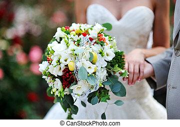 beautiful wedding bouquet at bride's hands