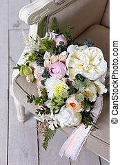 Beautiful wedding bouquet, forgotten on a vintage chair