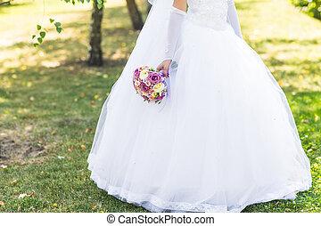 wedding bouquet in hands of the bride