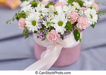 wedding bouquet in the basket on table