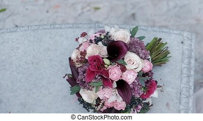 Beautiful wedding bouquet. Modern wedding floristry. Bouquet of roses.