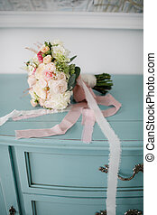 beautiful wedding bouquet of different flowers on a chair