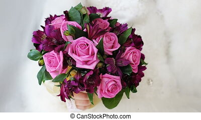Beautiful wedding bouquet of pink roses on a white background