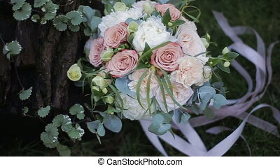 Beautiful wedding bouquet of white roses and creme...