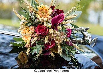 Beautiful wedding bouquet on car hood