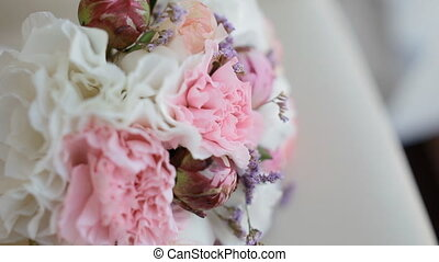 Beautiful wedding bouquet on the chair