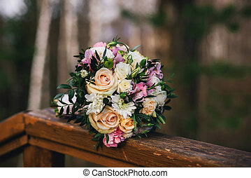 beautiful wedding bouquet with yellow roses, white chrysanthemums and pink Alstroemeria