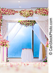Beautiful wedding ceremony design decoration elements with arch, floral design, flowers, chairs and balloons