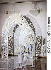 Beautiful wedding ceremony design decoration elements with arch, floral , flowers, chairs indoor